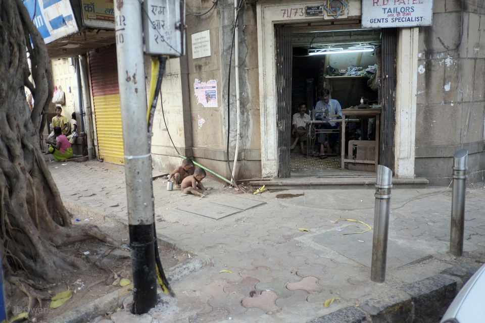 Bomba, there is always someone at work, and neary by street children play in the dust between the missing paving stones.